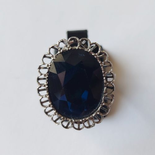 A platinum ring set with a large oval cut sapphire, probably from Australia (mis…