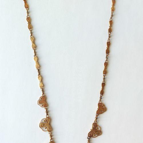 """COLLIER """"draperie"""" en or jaune 750°/°° à motif de sept éléments dégressifs ajour…"""