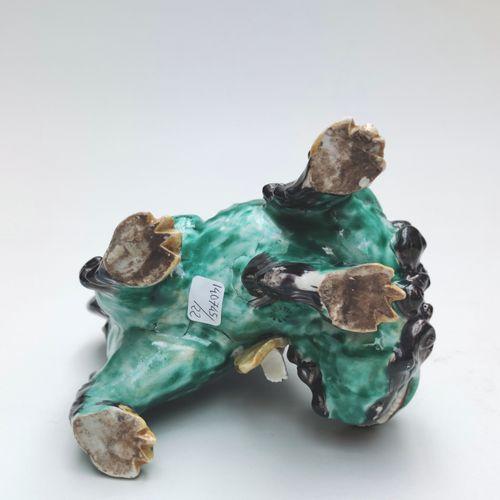 SUJET en céramique émaillée représentant une divinité assise sur une chimère , C…