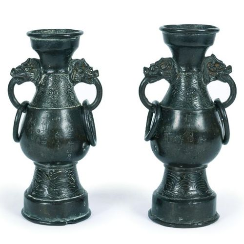 China, Ming period (1368 1644) Pair of two handled bronze vases decorated with c…