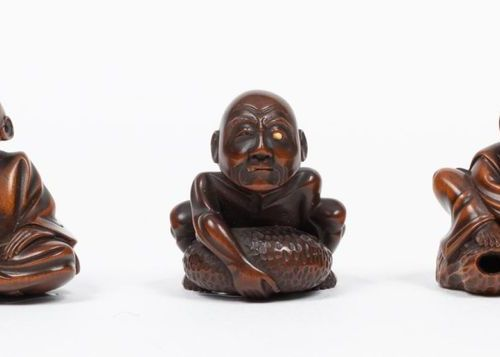 Japan, Meiji period (1868 1912) Set of three carved wooden netsuke inlaid with i…