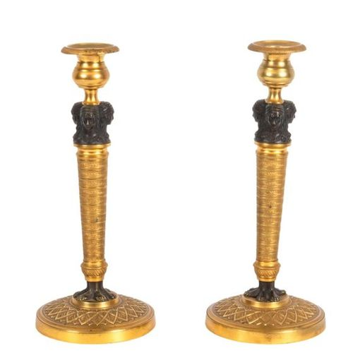 Pair of Empire style chased, patinated and gilded bronze candelabra with three c…