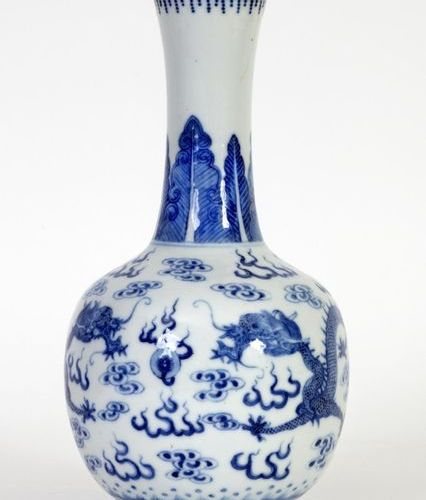 China, 19th century Porcelain bottle vase with blue white enamel decoration of d…