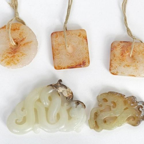 China, 20th century Lot consisting of five carved hard stone amulets. Two depict…