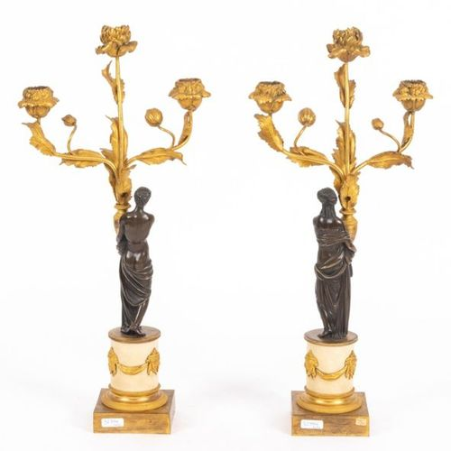 Pair of small Louis XVI style candelabra in chased, patinated and gilded bronze …