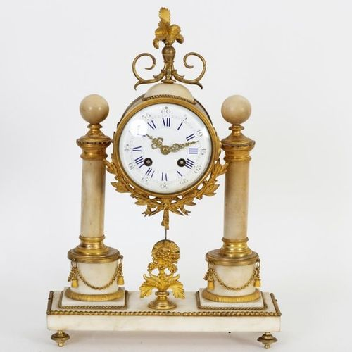 Small portico clock in the Louis XVI style in white marble and chased and gilded…