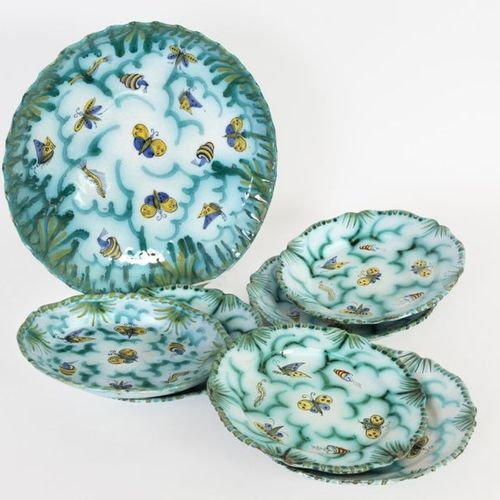 One dish and six crocheted plates in polychrome Brussels earthenware decorated w…
