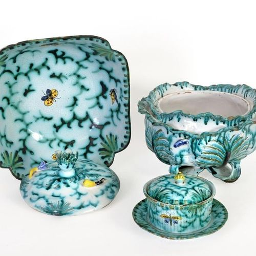 Set in polychrome Brussels earthenware decorated with insects and butterflies co…