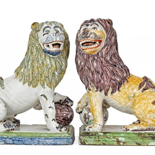 "Pair of ""Seated Lions, one paw on a globe"" in polychrome earthenware Probably a …"