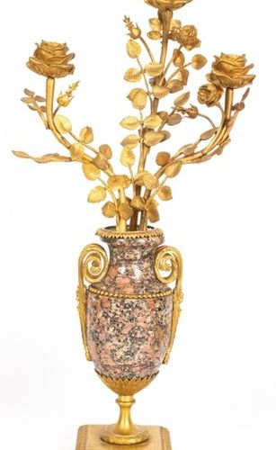 Pair of Louis XVI style candelabra in pink granite and chased bronze, gilded and…