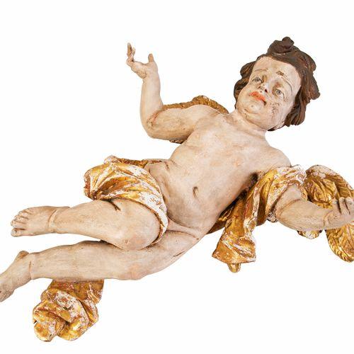 Angelot en bois polychrome sculpté représenté volant les bras écartés. Travail d…