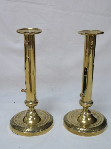 Pair of brass push pull candleholders. 21 cm (small dents)