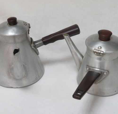 Set of two aluminium pourers. Circa 1940. 11 13 cm