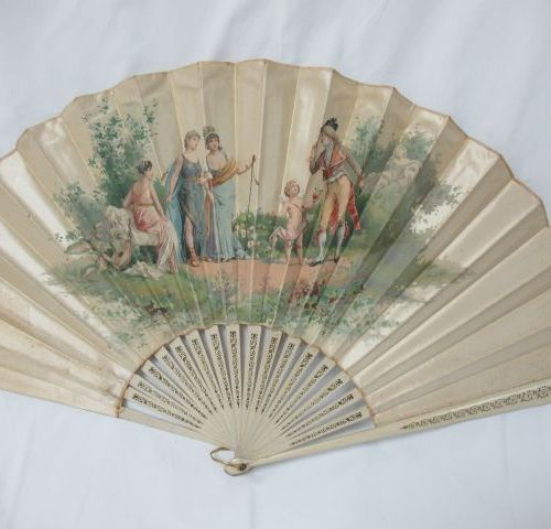 Painted wooden fan, covered with a lithographed cloth with a gallant scene. Bear…