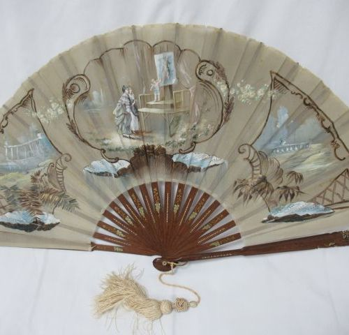 Carved wooden fan with gold highlights, covered with painted silk crepe, decorat…