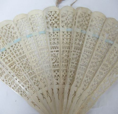 Set of two bone fans, one of which is covered with lace lined fabric and painted…