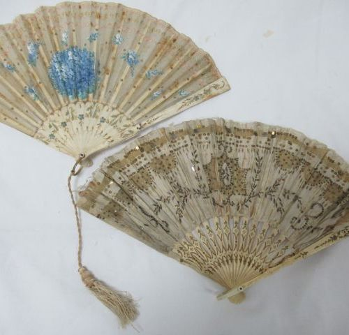 Set of two fans made of bone, covered with fabric decorated with sequins. One wi…