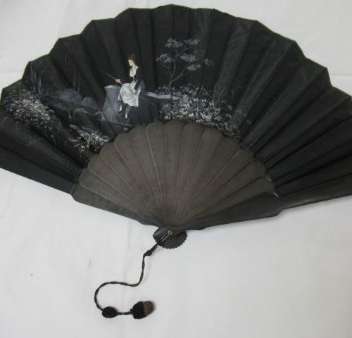 Blackened wooden fan, covered with painted fabric, showing a woman fishing. Sign…