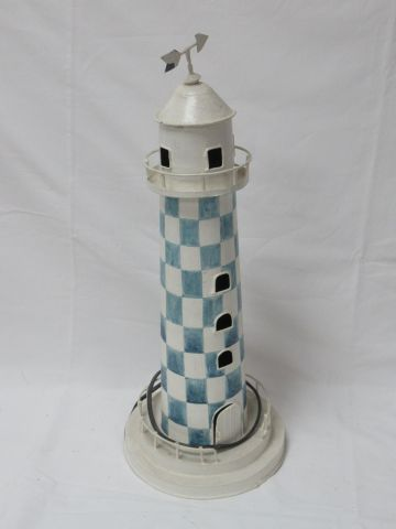 Lacquered sheet metal lamp in the shape of a lighthouse. Height: 46 cm
