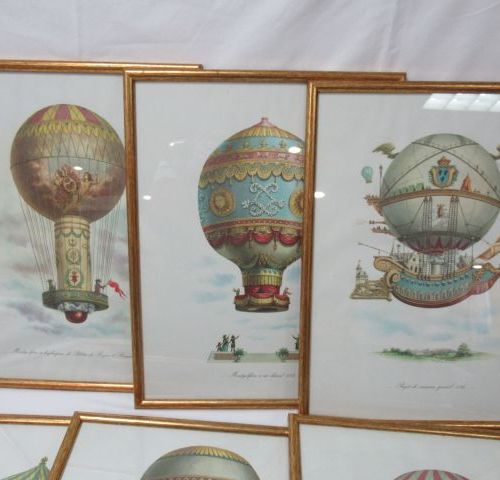 Suite of 6 color reproductions, on the theme of hot air balloons. Framed under g…