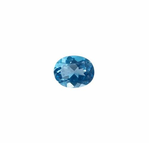 Faceted oval topaz on paper of about 3.19 carats.