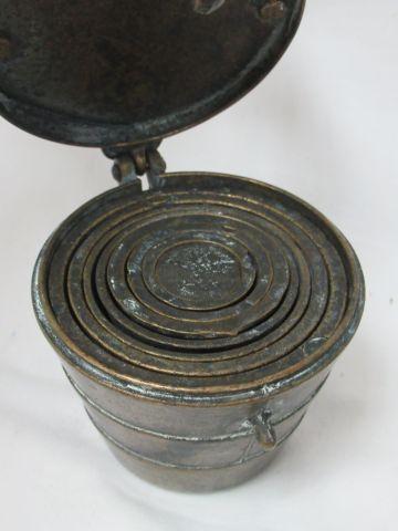 Bronze weight stack. Height: 6 cm