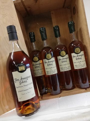 Lot comprising: 1 jar 150cl. Fine Armagnac Delord 40% vol  4 bottles Fine Armagn…