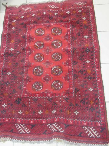ORIENT Wool carpet with geometric decoration on a red background. 122 x 82 cm