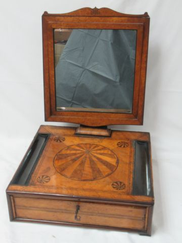 Writing case made of veneer wood, surmounted by a mirror. It opens to a pull out…