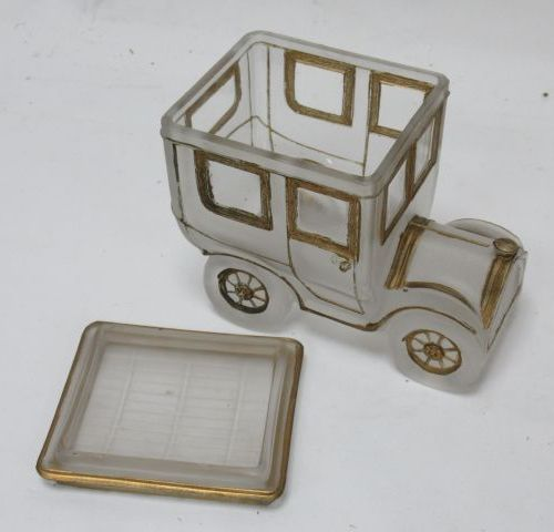 Frosted glass box with gold highlights, depicting an automobile around 1900. Hei…