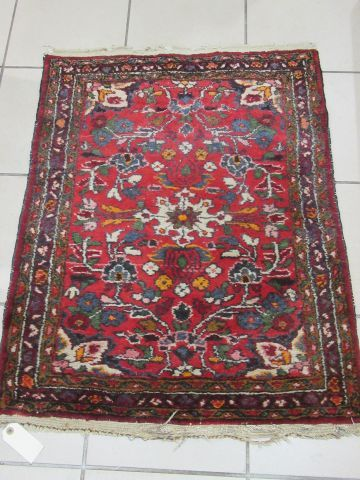 IRAN Wool carpet with stylised plant decoration on red background. 89 x 71 cm (e…
