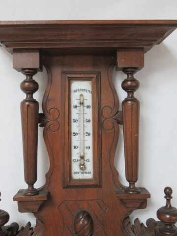 In the taste of the Black Forest, carved wooden barometer. 61 x 32 cm