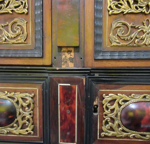 Cabinet in rosewood, ebony, stained tortoise shell and ivory veneer. It opens wi…