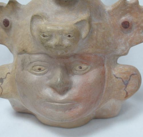Terracotta stirrup vase with male face decoration. Mesoamerica. Height: 30 cm
