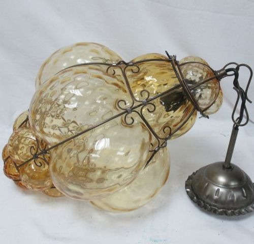 Suspension in smoked glass and metal. Height: 40 cm