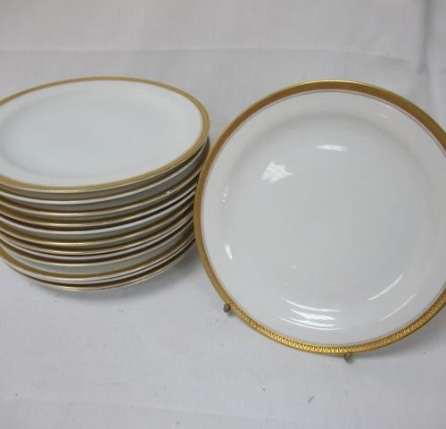 BAVARIA Suite of 14 dessert plates in white porcelain with gold highlights. Diam…