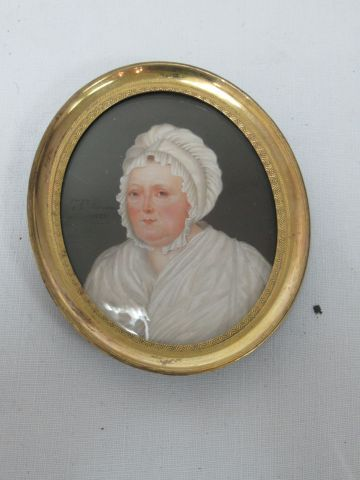 Miniature on ivory, showing a woman with a headdress. Dated 1822, signed as Rous…