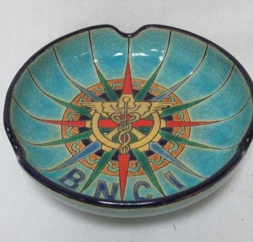 LONGWY Enamelled earthenware ashtray with caduceus decoration. Diameter: 13 cm