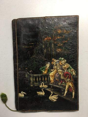 Very nice and old book cover in polychrome embossed leather showing a gallant sc…