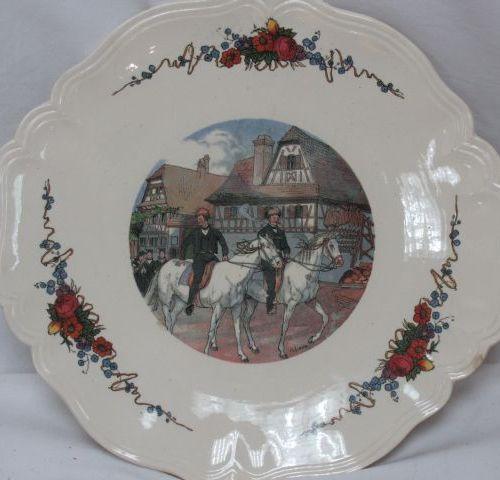 SARREGUEMINES, Obernai model, earthenware cake dish. Diameter: 29 cm