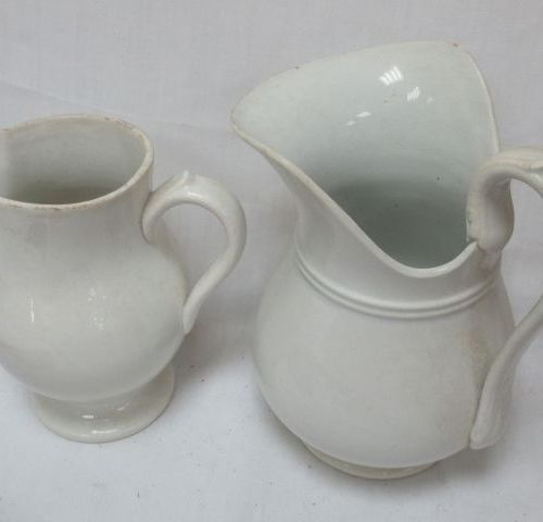 SAINT AMAND and HAMAGE Lot of two white earthenware pitchers. 16 19 cm (small ch…