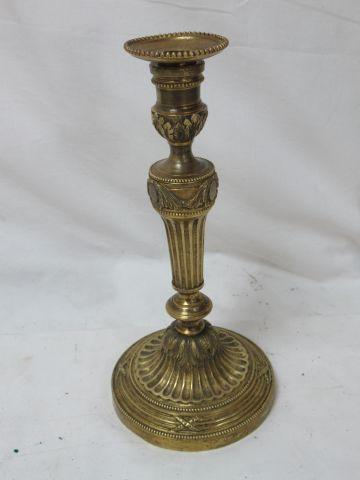 Bronze candlestick. Height: 28 cm