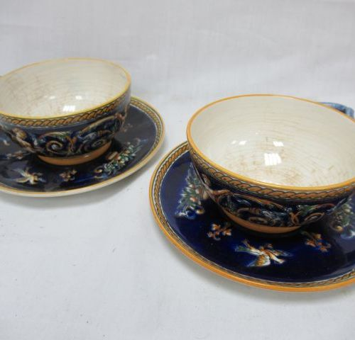 GIEN Pair of large earthenware cups and their saucers, Renaissance style. (stain…