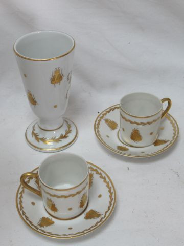 LIMOGES Set in white porcelain with gold highlights, decorated with bees, includ…