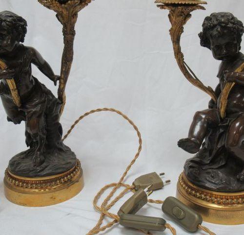 D'après CLODION, paire de candélabres en bronze doré, bronze patiné. Montés à l'…