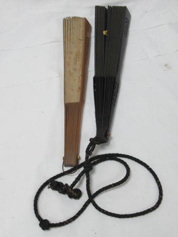 Lot de deux éventails en bois et tissu. (accidents à l'un) 30 x 55 cm