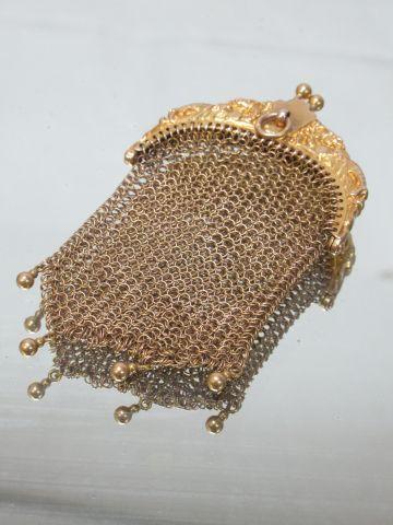 Bourse en or jaune 18K. Poids : 25,75 g Haut.: 8 cm