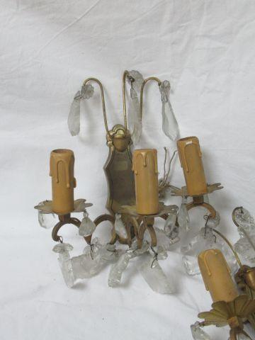 Paire d'appliques en bronze, à pampilles. 23 cm