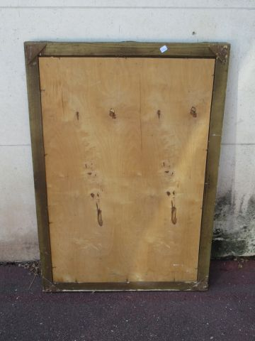 Miroir en bois stuqué et doré. Xxe siècle. 99 x 71 cm (nombreux manques)
