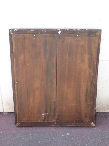 Miroir en bois stuqué et doré. XIXe siècle. 98 x 78 cm (usure, manques)